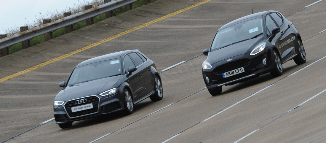 Audi A3 Sportback and Ford Fiesta driving on high speed bowl