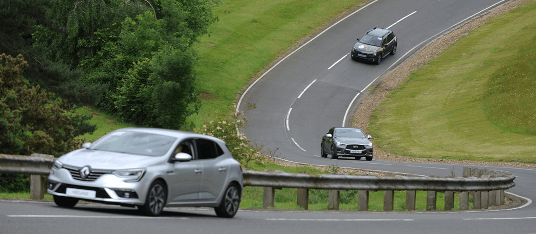 Renault Megane driving on gradient on Alpine Route
