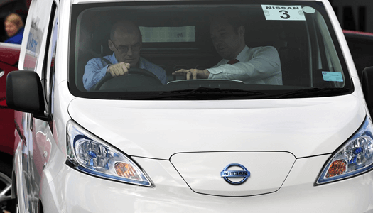 Manufacturer representative and driver talking in Nissan van